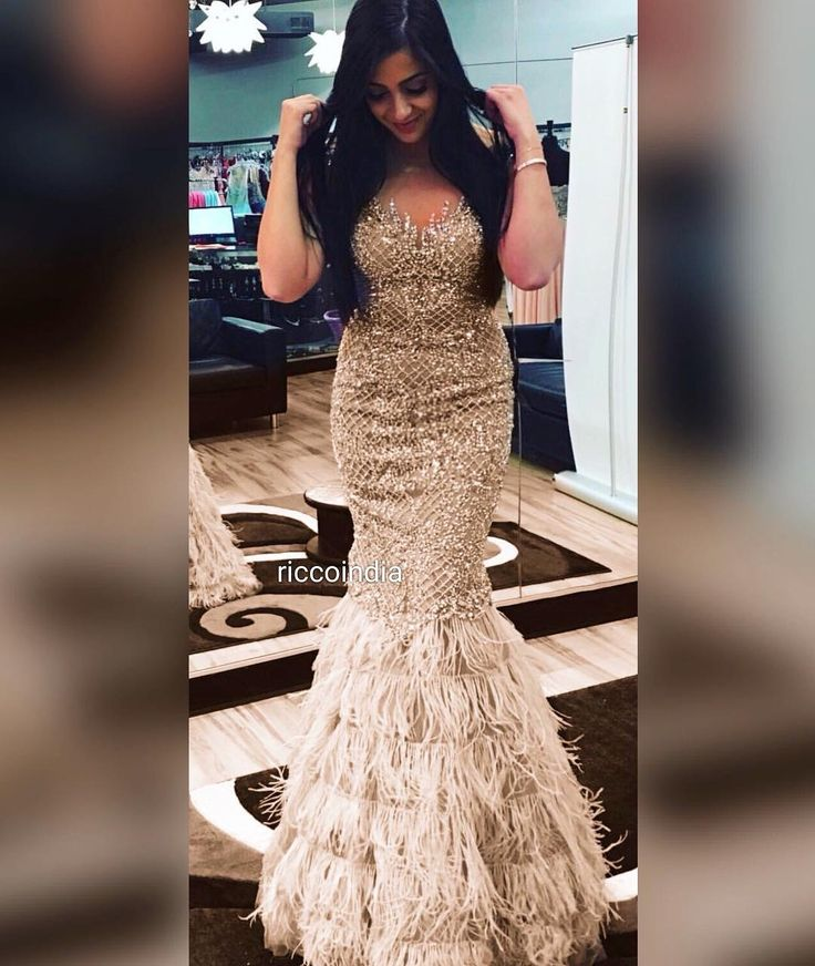 Custom made intricately embroidered fish cut gown with feather bottom with train