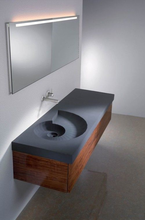 This unique washbasin is a joy to use and look at. High Tech Design Made of molded concrete the water cascades down before draining. Courtesy of High Tech Design