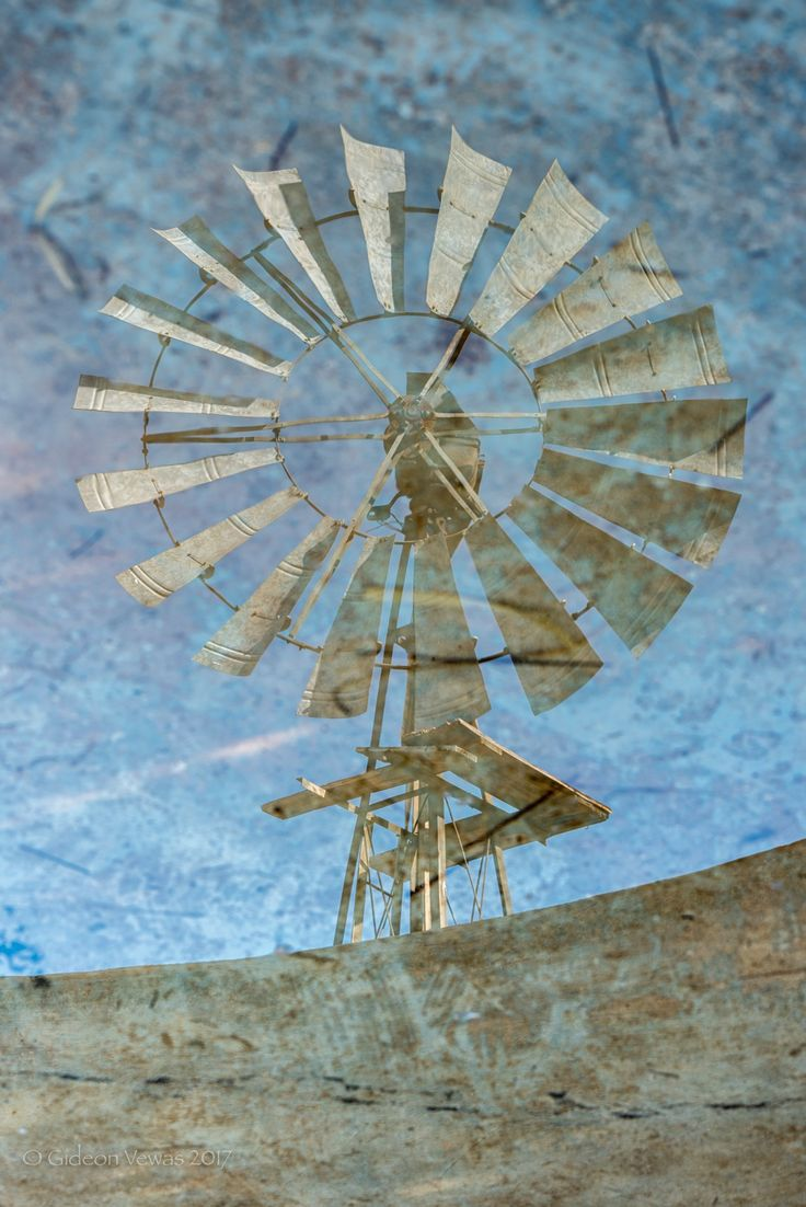 Photo of windmill reflection turned upside down #windmill, #reflection