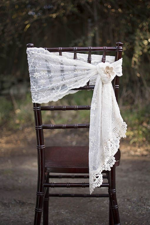 Our ivory lace runner can also be used as a flowing chair sash.