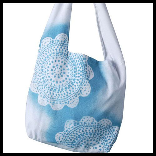 Get an instantly cool effect on a tote or t-shirt using a doily and Tulip Fabric Spray Paint. @ILoveto Create