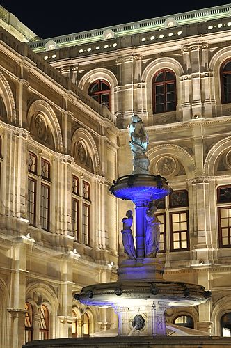 A fountain outside of the Vienna State Opera House. AUSTIRA    Beautiful at night!