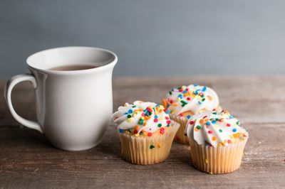 Cup of tea with cupcakes