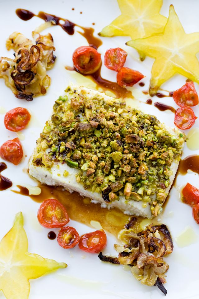 Pistachio-Crusted Halibut with Fennel Balsamic Gastrique- halibut, olive oil, apple cider vinegar, pistachios, sea salt, grape tomatoes, fennel, shallot, star apple (or carambola), balsamic vinegar, honey.