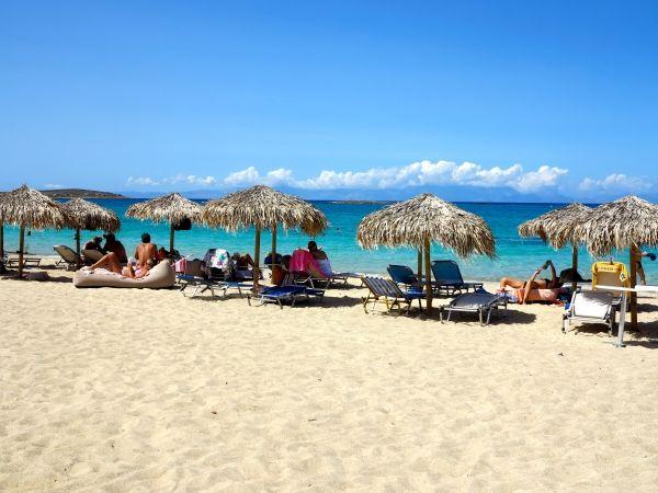 Umbrellas and white sand at Panagia beach