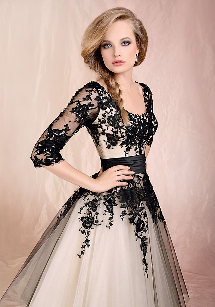 Black lave overlay over a white ball gown