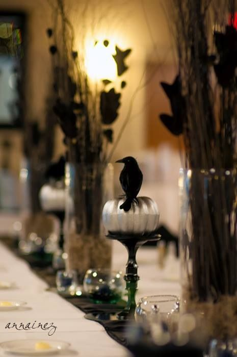 A view of the bridal head table at my wedding reception. Gothic classy Halloween wedding masquerade reception. Black and silver. Pumpkins crows ravens. Dark blue candles.