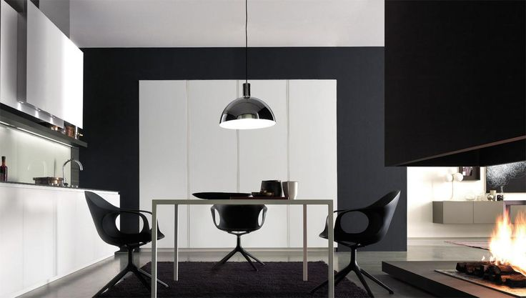 Inspired by the concept of #minimaldesign, the kitchen environment shows a new style, which is emphasised by the glass doors and the dark stained oak top and boiserie. Finishes call to mind the other environments of the home: everything is seamlessly co-ordinated. #designkitchen http://www.modulnova.com/project-project-10