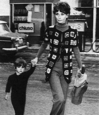 Signora Audrey Hepburn Dotti photographed with her son Luca in Rome (Italy), in March 1972. Audrey was wearing: Sweater: Valentino (red, of his couture collection for the Autumn/Winter 1970/71).