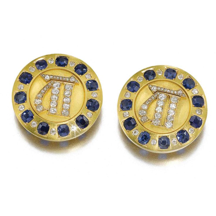 THE ELEVENTH WEDDING ANNIVERSARY: A PAIR OF FABERGÉ JEWELLED GOLD CUFFLINKS, WORKMASTER AUGUST HOLMSTRÖM, ST PETERSBURG, CIRCA 1885 each centred with diamond-setOld Slavonic numeral 11, also readable as initial M or MP (Cyrillic) for Grand Duchess Maria Pavlovna, within a border of sapphires and diamonds, struck with workmaster's initials, 56 standard diameter: 3.1cm, 1 1/4 in. Estimate 3,000 — 5,000 GBP  LOT SOLD. 73,250 GBP