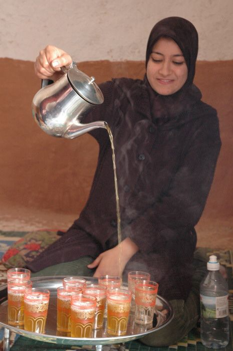 Moroccan tea being served: It is poured from a distance to produce a foam on the tea | Photo from blueshawk's photoblog. http://www.blueshawk.info/texasflood/morocco_village.htm via http://commons.wikimedia.org/wiki/File:Minttea.JPG | Permission: CC BY-SA 2.5 http://creativecommons.org/licenses/by-sa/2.5/deed.en