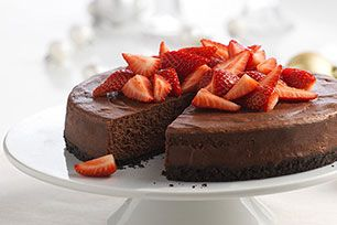 This chocolate cheesecake is truly majestic—unbelievably rich and incredibly impressive. Think of those berries on top as an edible tiara.