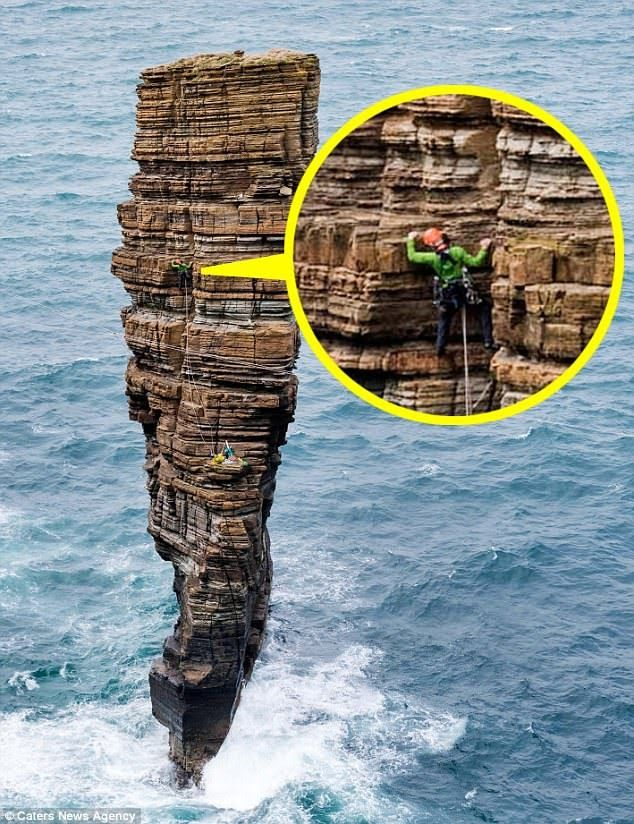 The four adventurers were photographed their way up a mass of rocks (pictured) on Orkney's west coast, known as 'The Castle', to stand triumphantly on the top as the wave crash below.