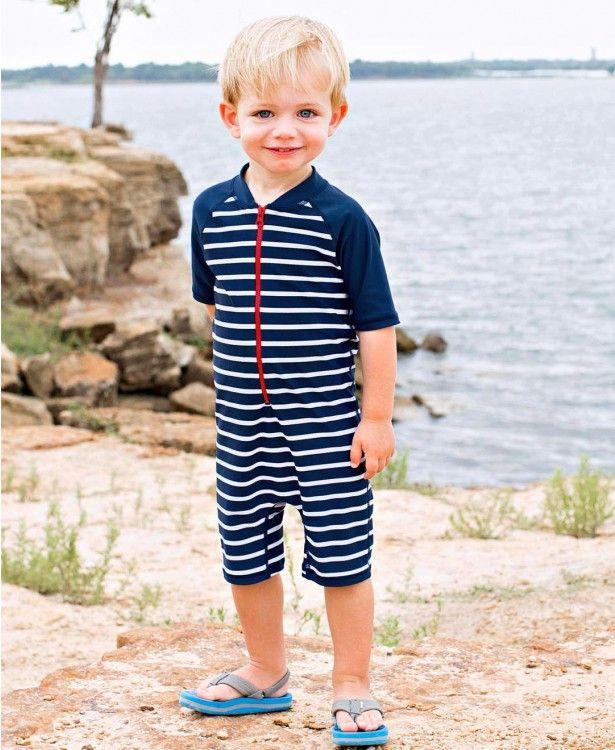 c5c0c50eb9580 Navy Stripe One Piece Rash Guard - RuffleButts.com This one piece rash  guard will be your go to for those kiddos that won't allow you to apply  sunscreen.