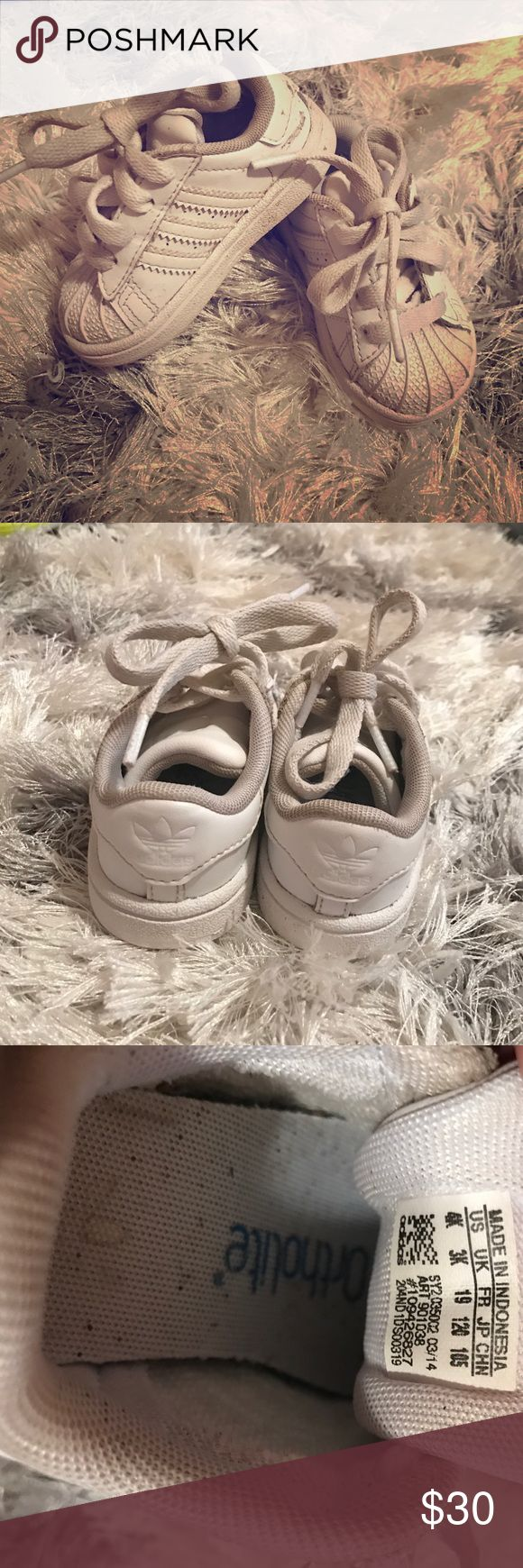 Adidas superstar toddler shoes size 4 All white adorable Adidas superstar shoes toddler size 4. Goes with everything and great for boy or girl. Adidas Shoes Athletic Shoes