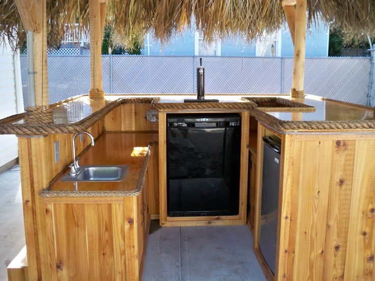 Derby, CT -  9x8 custom red cedar tiki bar, 11 x 10 thatched roof, footrest, electric, ceiling fan with light kit, rope lighting, fridge, beer meister, sink, marine grade cherry plywood upper and lower bar tops, cabinets, tv and stereo hook up.   Full photo album can be seen here on facebook - https://www.facebook.com/tikikev/photos_albums  For more info go to www.tikikev.com or call 800-792-8454 , email: tikikev@tikikev.com