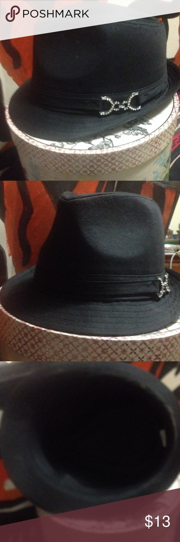 Black Glitter Fedora This is a nice black Fedora!! Like new, bought and wore once. I love he look of fedoras, but they just aren't me. I have 2 more listed that I purchased with this one. I never wore those 2, they are still new!!! This would be hear to wear with anything!!! Even in the bedroom!!! Lol Other