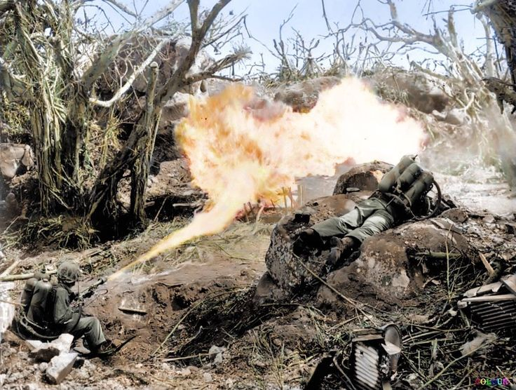 #WW2ColourisedPhotos ..... Two US Marines direct flame throwers at Japanese defenses that block the way to Iwo Jima's Mount Suribachi,  February 20 1945.