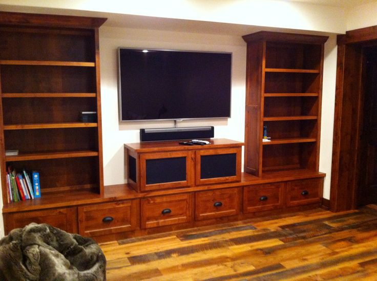 Entertainment Center with ample storage and bookshelves in the Children's Playroom.