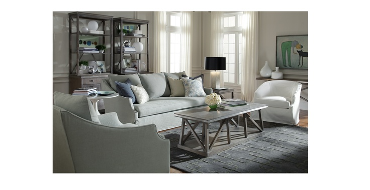 "morgan collection. traditional shape to the arm matched with loose slipcover.  ""Slipcovered collection with slim arms sloping down from a high back. Sumptous bench seat, with plush back cushions. Filled slipcover accentuates arm shape and versatility of the Morgan."""