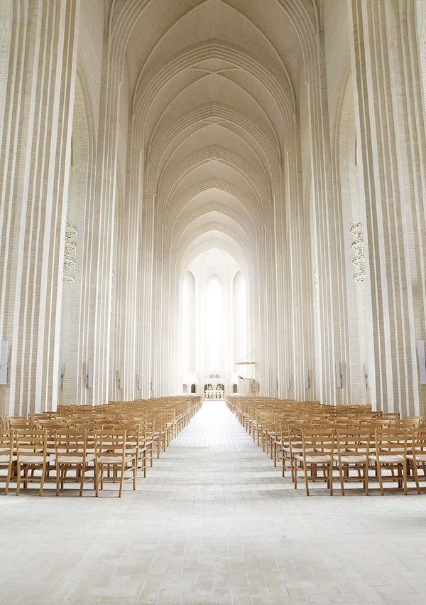 Repetition; Inside this beautiful chapel, there is repetition due to the fact that the chairs are repeated all throughout while the ceiling has the same pattern over and over.