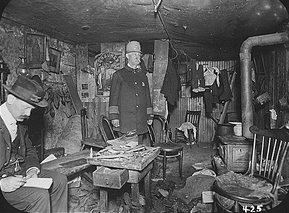 A picture, taken in 1900, of investigators examining an overcrowded tenement house fit for  nine. When burdened by the prices of food, clothing, and even rent, most immigrants in New York were  forced to live under unfit conditions in order to make ends meet.  (The New York City Tenement Investigation, 1900)