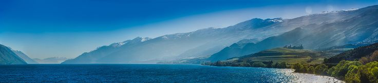 Mist rises from Lake Wakatipu. The Hector Range, near Kingston, to Coronet Peak near Queenstown