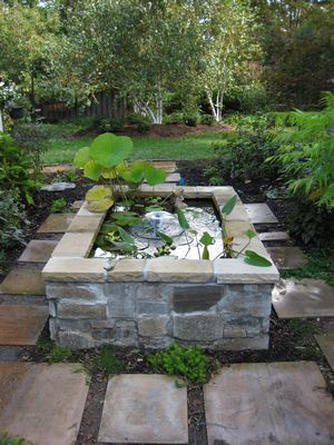 Going to make something similar to this using natural elongated stones from our cabin property, and its going to be a koi stand up pond!