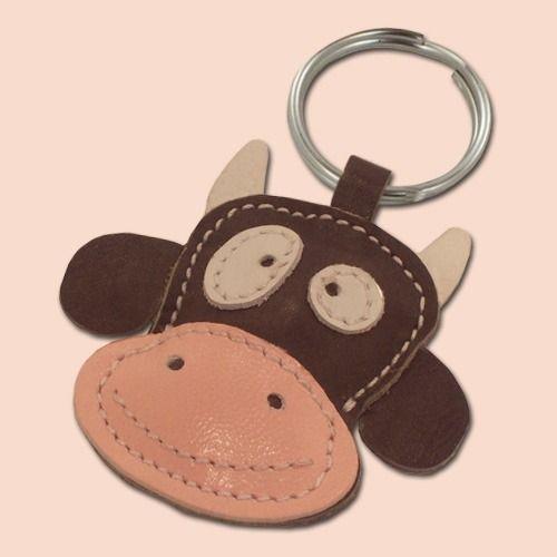 Un joli petit vache brune cuir animal porte-clé