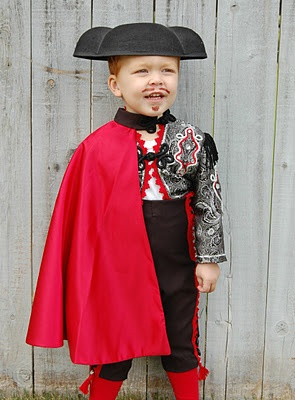 The ring bearer of course! The red would be replaced with a gray or silver though and his hat would be more sombrero like