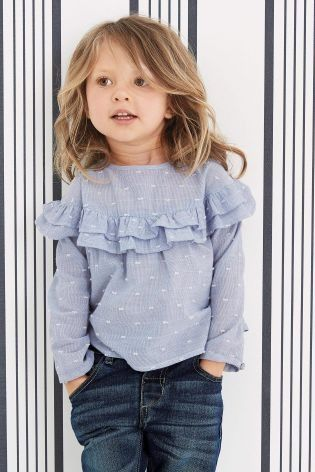 How on TREND is this little one with this Blue Ruffle Blouse!