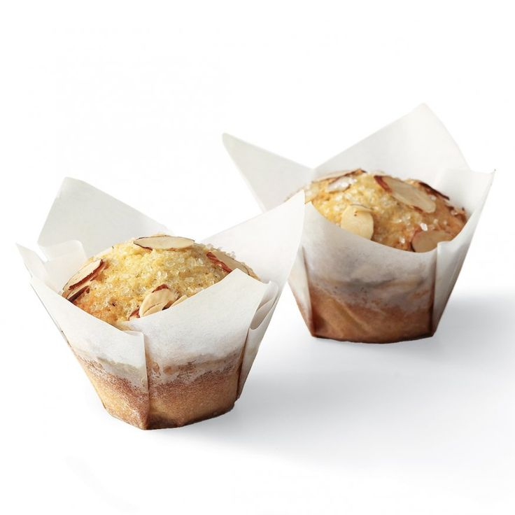Cut 5-inch squares of parchment paper to make these pretty crisp muffin wrappers.  Great for baked gifts.