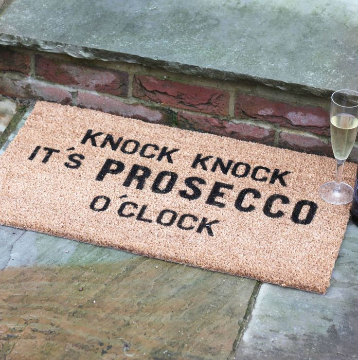 This doormat is just perfect for us Prosecco lovers, and a great housewarming gift for friends. 'Knock Knock It's Prosecco O'Clock'.Designed by, and exclusive to, award-winning typographic art boutique More Than Words. Make a statement in the neighbourhood, with this 15mm internal coir coconut husk mat with black text. Ideal for internal and sheltered areas of your home, removing dirt and water from boots and shoes. To clean, simply shake and brush down.Made from natural coir and a pvc…