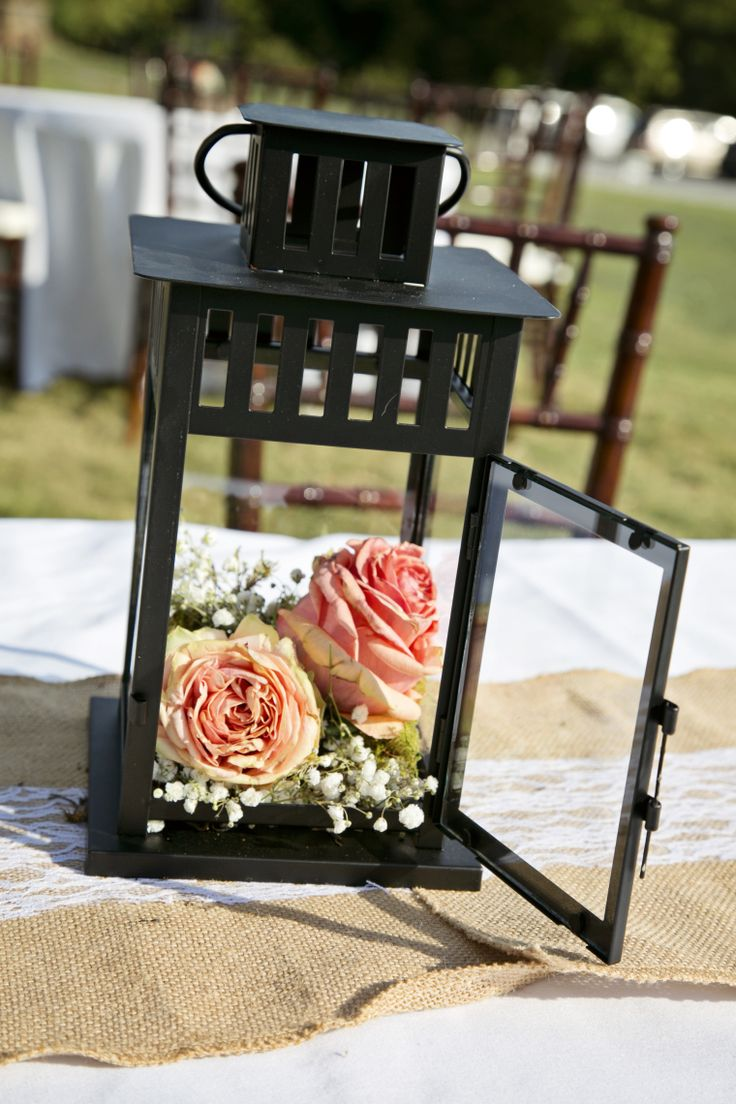 Lantern with baby's breath and roses