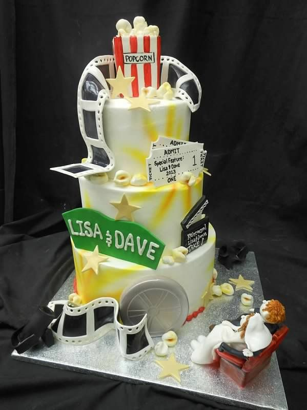 Movie themed wedding cake with lots of gum paste accessories