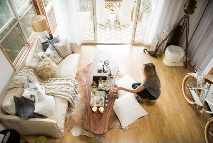 7-foot-long coffee table made from a raw slab of monkeypod wood, sanded & stained.  Photo curtesy: Houzz