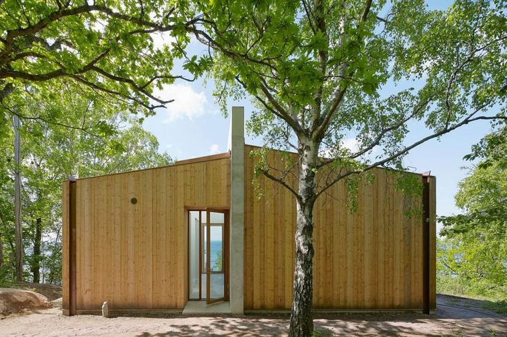 This contemporary lakeside cottage in Sweden has 3 small bedrooms in 1,249 sq ft. |