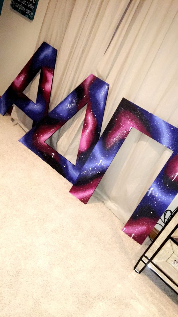 Hand painted galaxy on wooden Greek letters