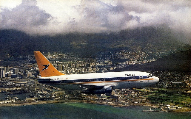 SAA  over Granger Bay   1985  The Boeing 737, Olifants, of the South African Airways makes a low pass over Granger Bay.  No sign of the Waterfront yet!