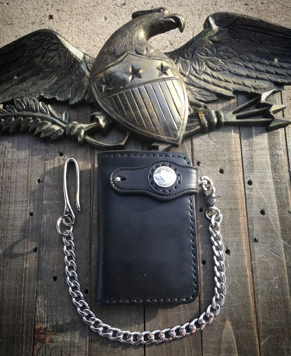 The American mid wallet measures 3.5x5.5 inches Made from veg tan bridal leather (same leather used for horse tack/extremely durable) Features 8 card pockets (2 hidden) and a slot for cash Silver indian head or buffalo concho Lifetime guarantee