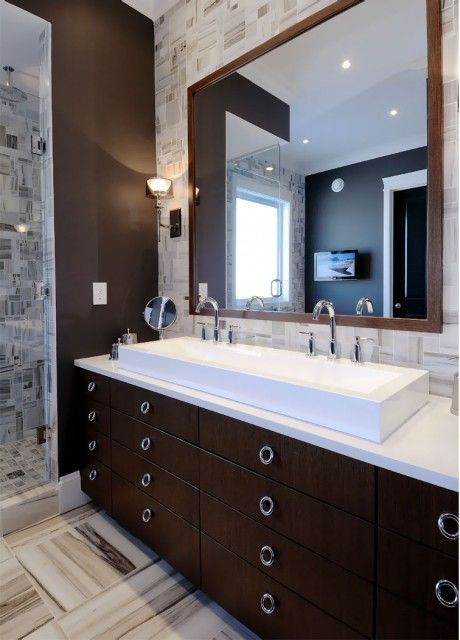 modern, contemporary espresso bathroom design with modern espresso bathroom vanity sink, white porcelain rectangular sink, polished nickel modern faucets, wood bathroom mirror and ivory & chocolate brown tiles walls.