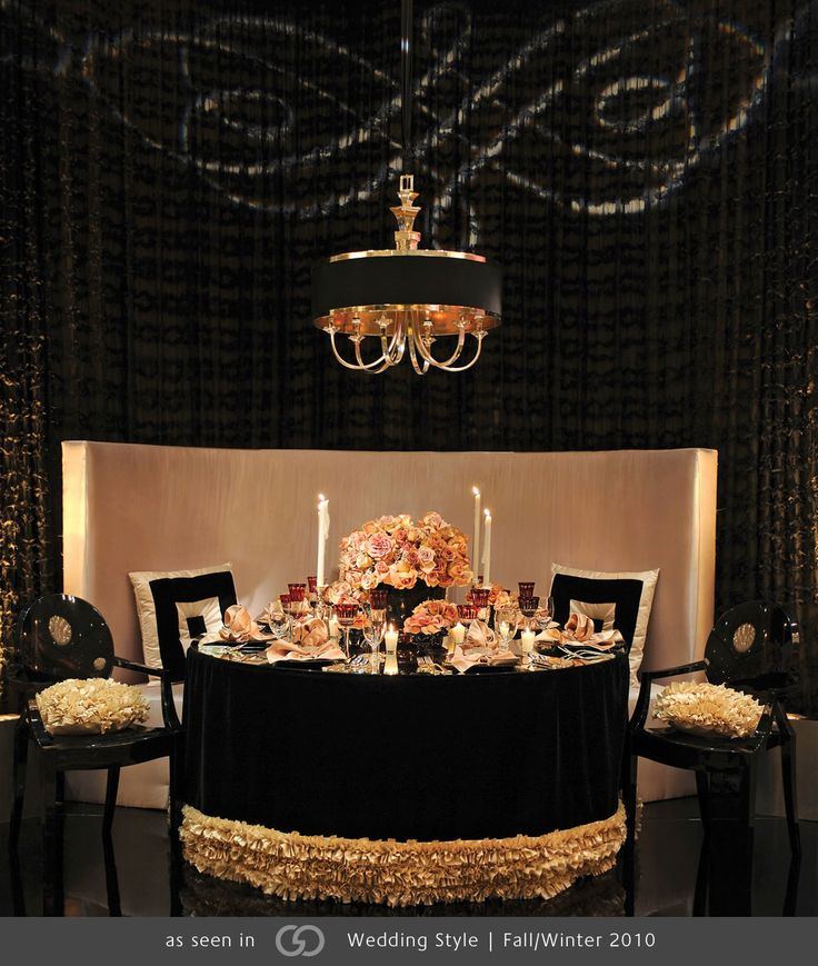 Chinese rice flower and Amnesia roses presented on a mirrored tabletop set on black velvet with a champagne ruffle border.