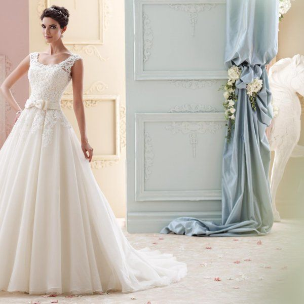 Even if you're not getting married at Buckingham Palace, you may still want a modest wedding dress that's appropriate for church or temple. It's never been chicer to cover up with alluring sleeves or a timeless bateau neckline — even celeb brides like Nicky Hilton are opting for a classically-inspired look when it comes to their big day.