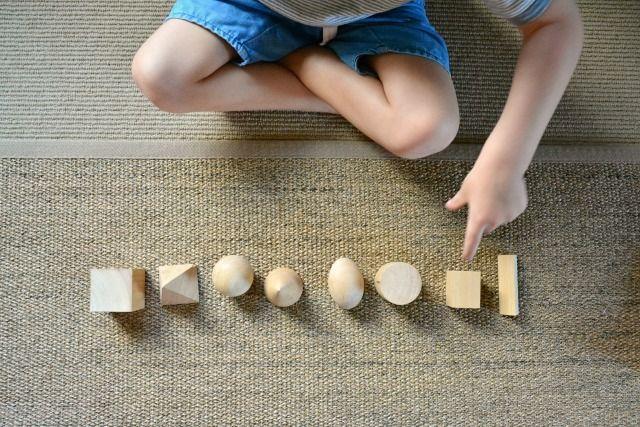 Missing Object Game - Otis naming the geometric soilds at How we Montessori June 2015