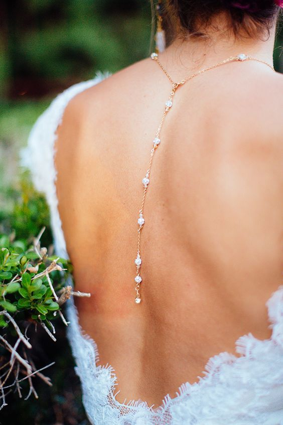 A backdrop necklace is the perfect bridal accessory for a low cut gown.