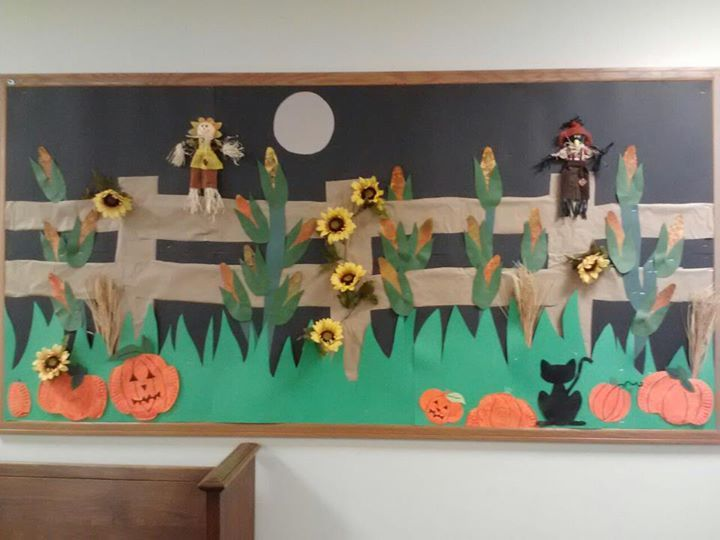 This was another autumn themed bulletin board.  It was my favorite one all year because it was so three dimensional with the actual flowers and scarecrows! The students made the ears of corn and the pumpkins themselves!