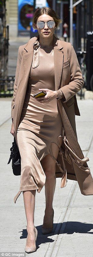 Gigi Hadid flaunts her model curves in tight beige dress that's slashed at the hip as she steps out in heels | Daily Mail Online