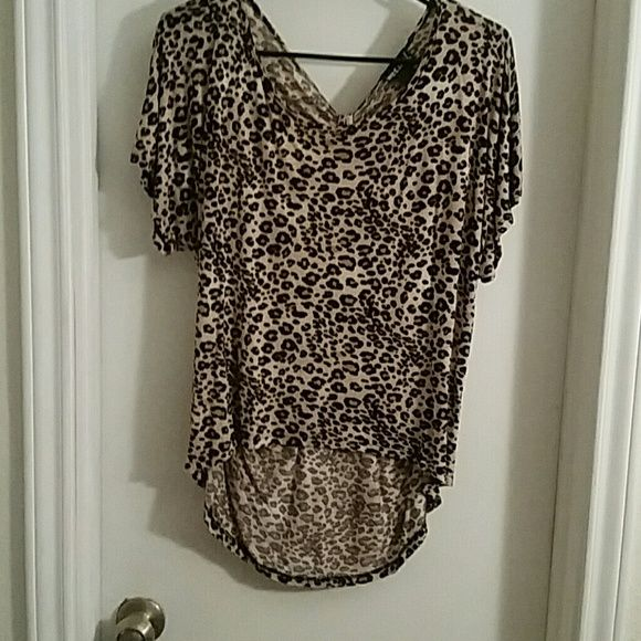 Leopard shirt/wet seal Wet seal leopard shirt. Beautiful back and front leopard shirt! Perfect condition! Only worn once! Wet Seal Tops Blouses