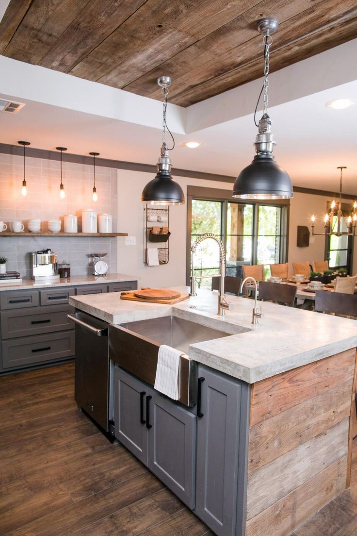 Shelves, industrial lighting, wood ceiling, open concept, concrete countertop, kitchen sink in island