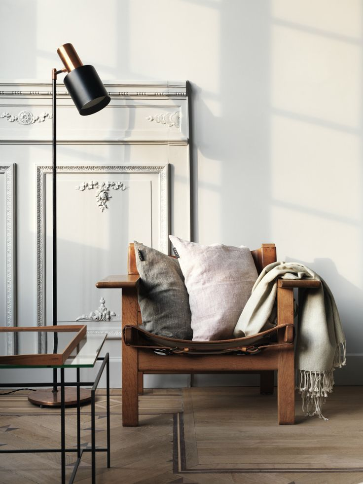The Spanish Chair by Børge Mogensen filled with pillows for a cozy feel.